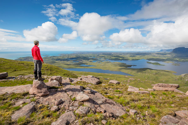 Hillwaker on Stac Pollaidh. Photo by Kenny Lam / Visit Scotland